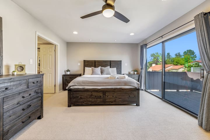 Comfortable master bedroom with reading lights