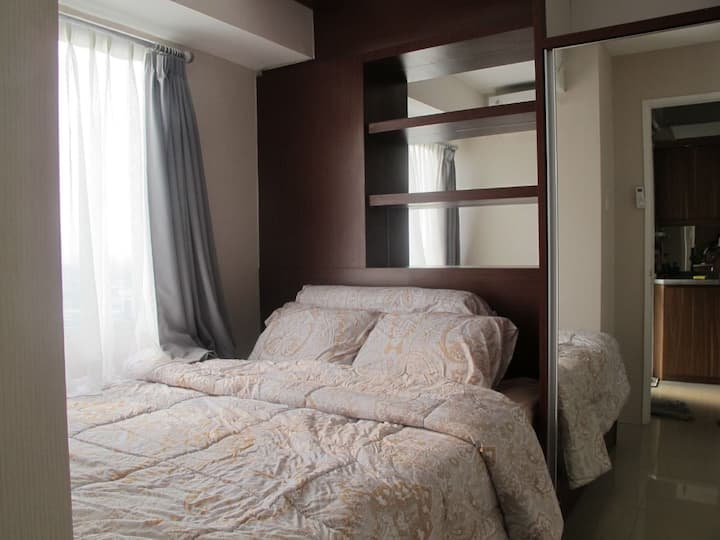 Homey Clean Unit Above Bassura Mall with City View