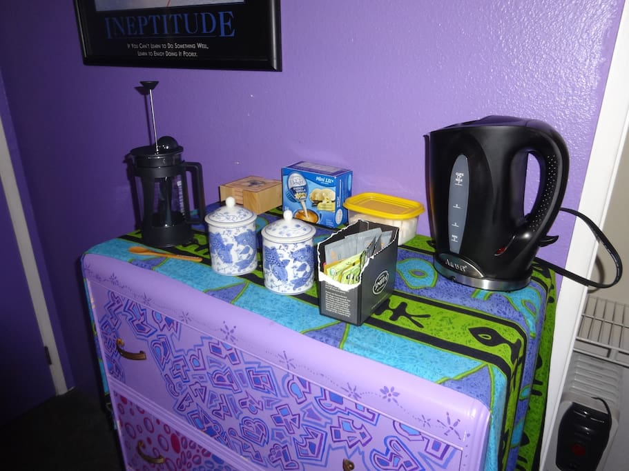 Hot water heater with choice teas (many more in the kitchen) and French press for coffee