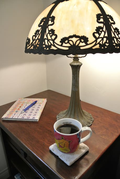 Read by the light of your antique glass lamp.