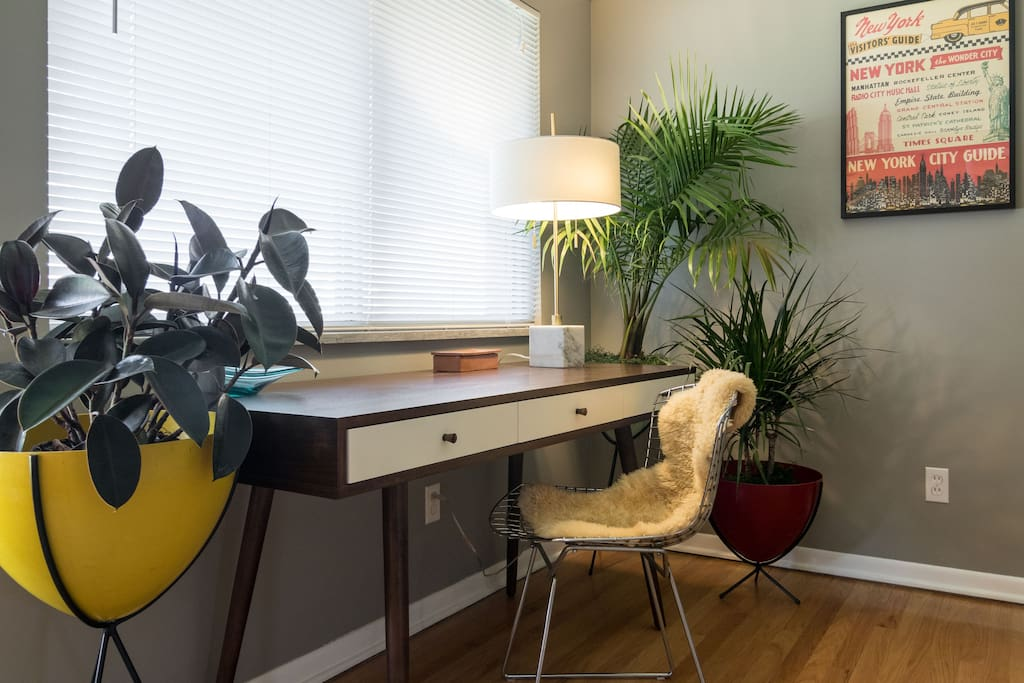 Business ready with a nice large mid century desk in the living room.