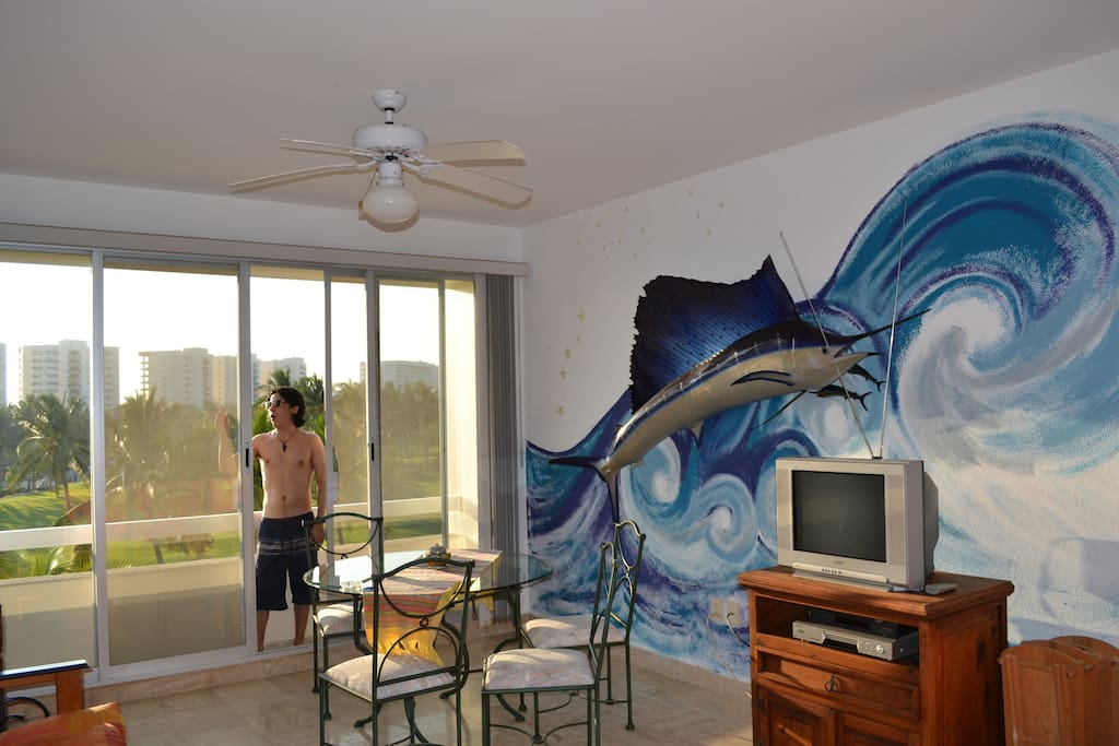 Living Room, Balcony and sea waves on the wall (painted by our family!)