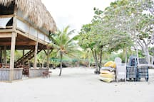 Beach area with kayaks, palapa & volleyball