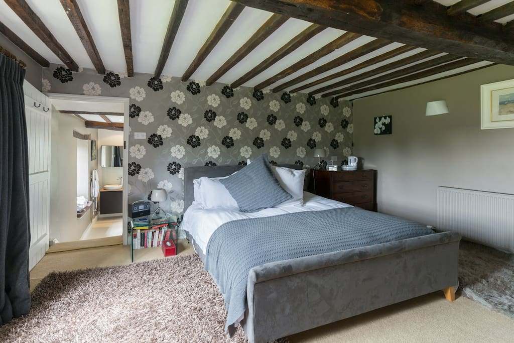 The master bedroom with superkingsize bed and ensuite bathroom...