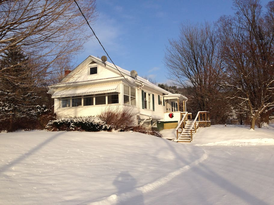 This charming 3 bedroom home with, one bath and screened porch sits on an acre of land.