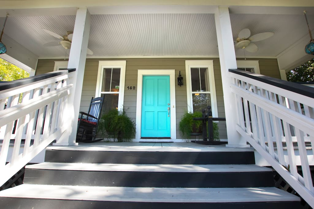 Welcome through the teal door! This house sits on nearly 1/2 acre. More privacy than most.