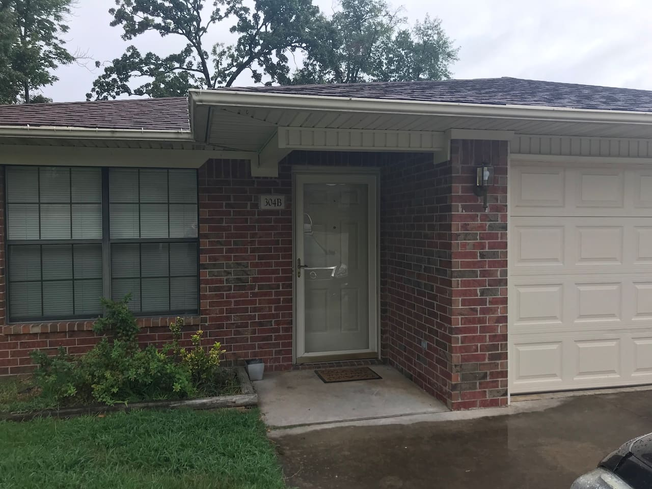 Front of Apartment with Garage for your convenience.  Keypad entry.