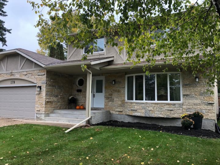 Hidden Enclave Executive Property in Charleswood!