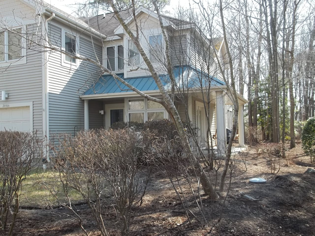 Blocks from the beach! Corner unit.  Beautiful wooded setting on a quiet street