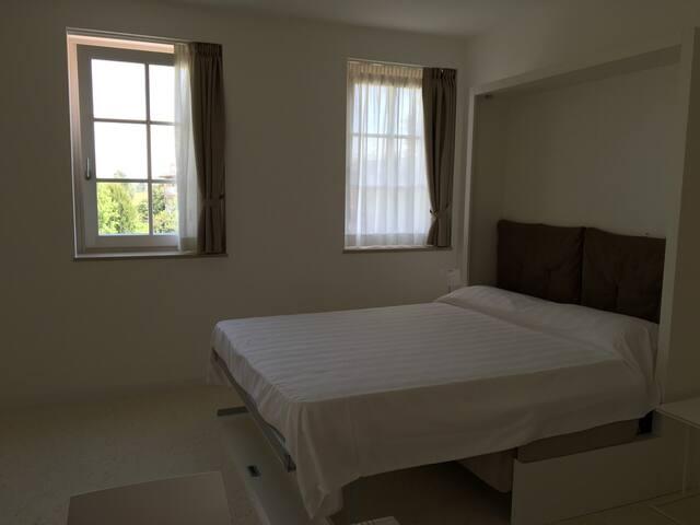 letto matrimoniale/ sofa bed-queen size