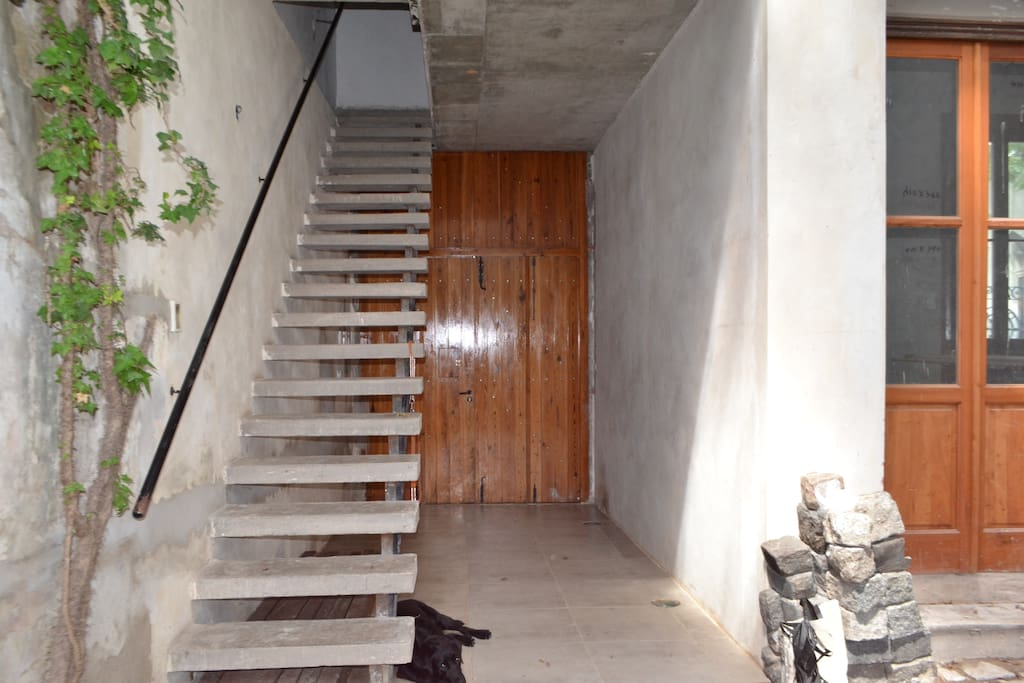 1st floor loft access stairs just next to the main 100 years wooden gate