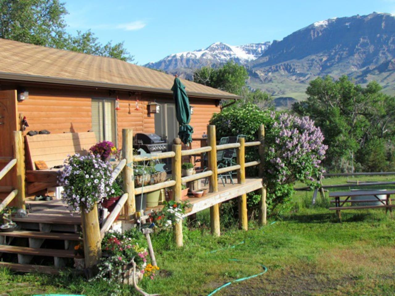 View of Jim Bridger Mtn., large porch with bar be que, picnic table, surrounding lawn, ON Whit Creek