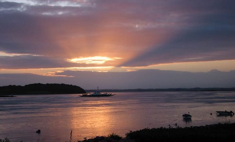 The setting sun streams into your living room as the ferry boat crosses  between the Conservation villages of Strangford and Portaferry