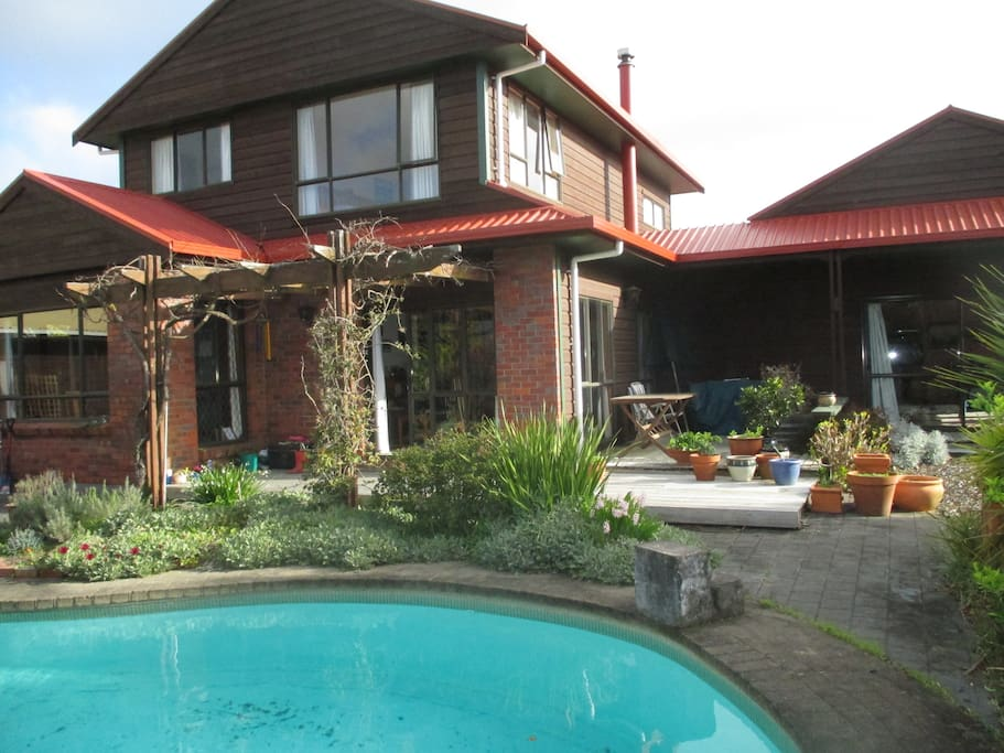 Outside verandah, garden area and pool.