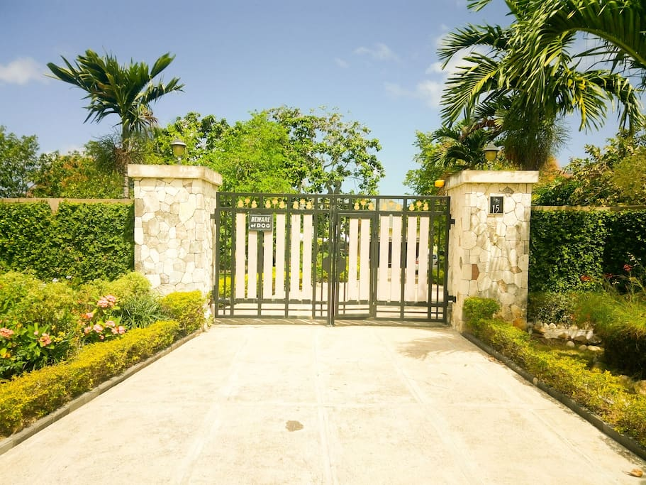 property well secured by automatic gates and alarm system