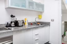 You can find all basic kitchen amenities. A very spacious kitchen will be good for a group vacation, you can cook here and use the kitchen with all amenities:  + Water cooler + Kitchen stove + Big Fridge + Microwave  + Toaster + Blender