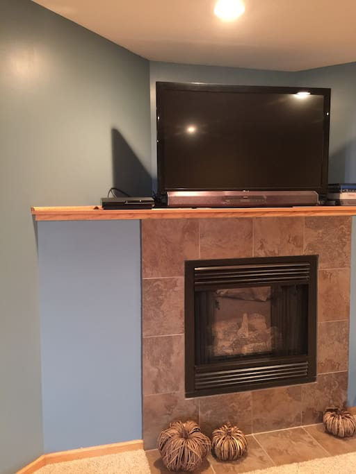 Gas fireplace and tv with streaming capability in den