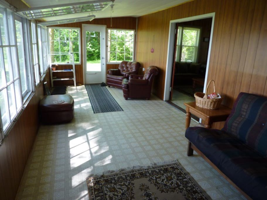 Sunroom easily converts to a screened room. Clip hinged windows to ceiling to enjoy the wonderful lake air! Futon can sleep two.