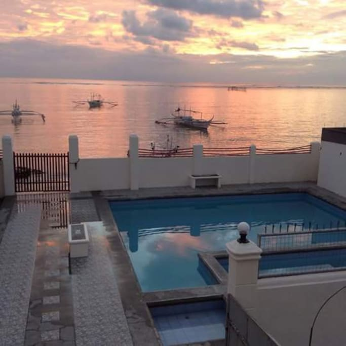 View of the pool and the sunset from the terrace...