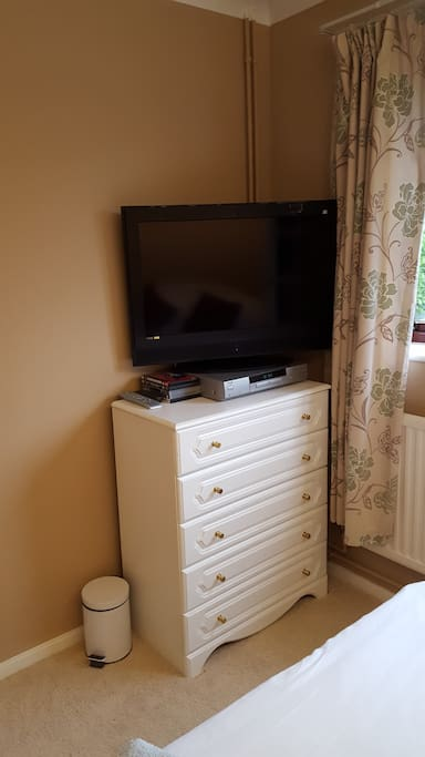 TV and DVD with chest of drawers.