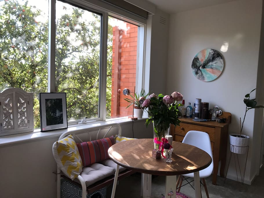 The apartment is filled with natural light from the large windows