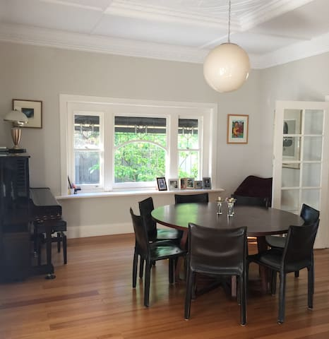 Dining room can seat 8 people around the table. Windows look out to side garden, and has french doors leading to back deck.