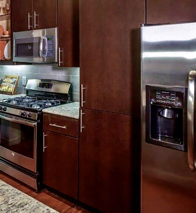 Large fully furnished & equipped Chef Kitchen with gas stove top for cooking.