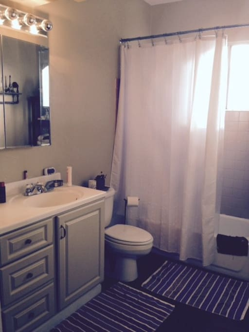 Upstairs bathroom with bathtub, 2 sinks and your own space