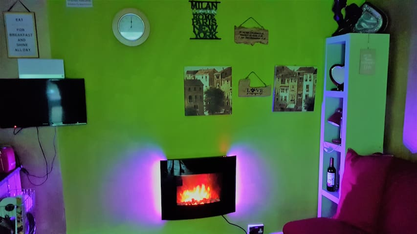 Enjoy the calm colours&Change the mood with the luxury Hi-Tech fireplace with side bars'background lights :)