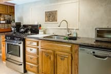 Fully equipped kitchen to prepare your own meals. Includes gas range, toaster oven, microwave oven, coffee pot, Kuerig, dishwasher and more.