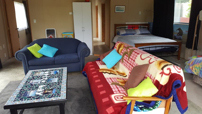 The open plan sleeping / living area in the bach (ONLY AVAILABLE WHEN BOOKING 5+ GUESTS)