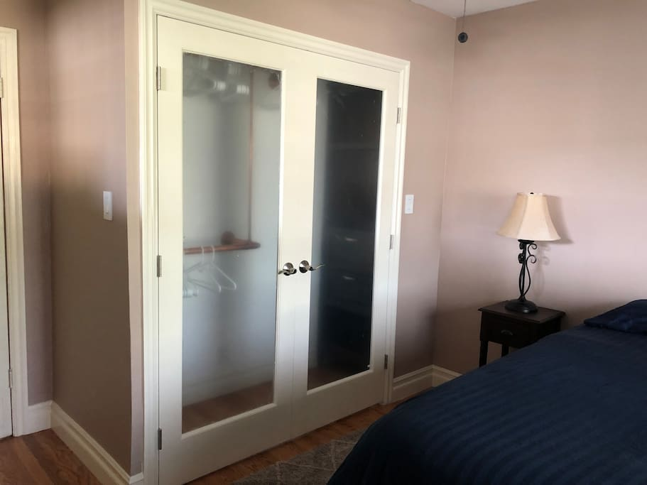 Large closet with French doors