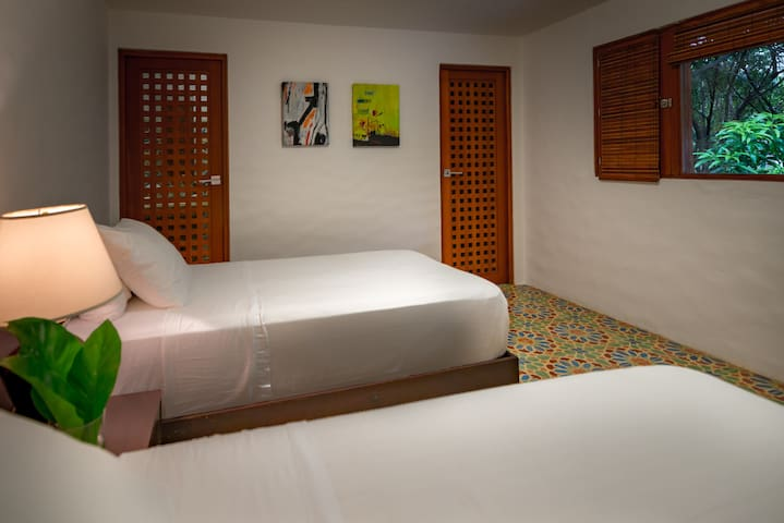 One of three junior suites with twin beds
