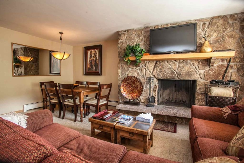 """Gather with family and friends and watch a movie on the 42"""" flat screen TV/DVD or relax and warm up around the wood burning fireplace."""