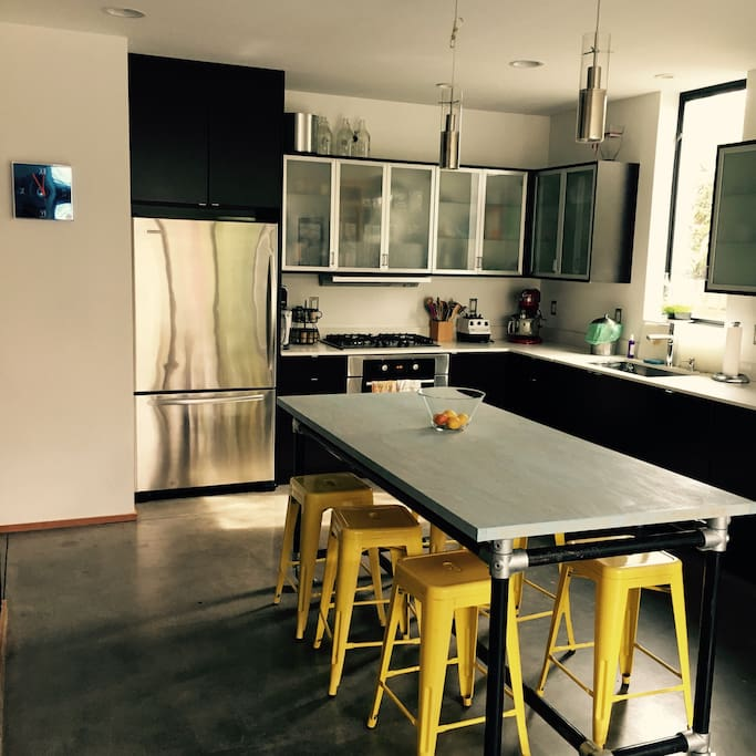 Kitchen with counter height island table.