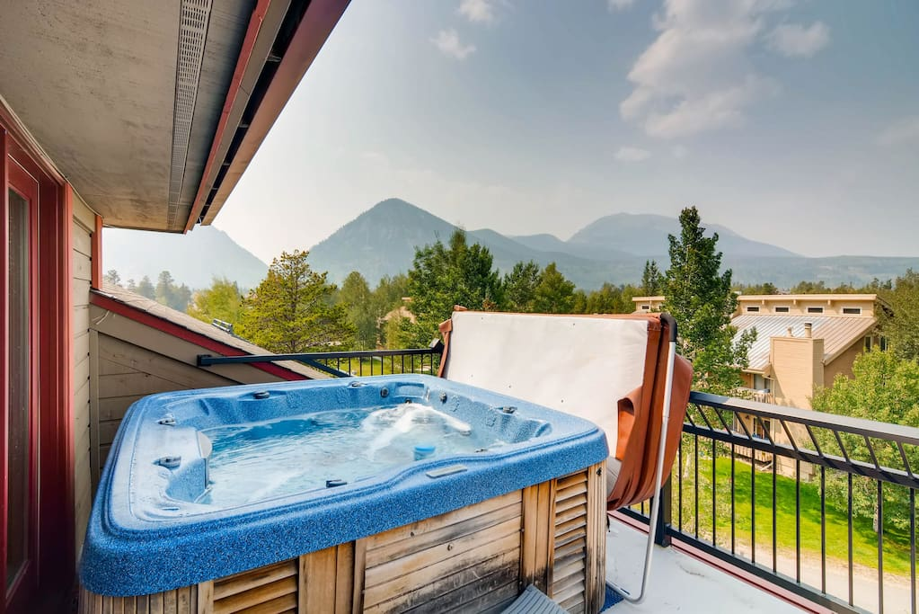 Soak in the outdoor hot tub and drink in the mountain views