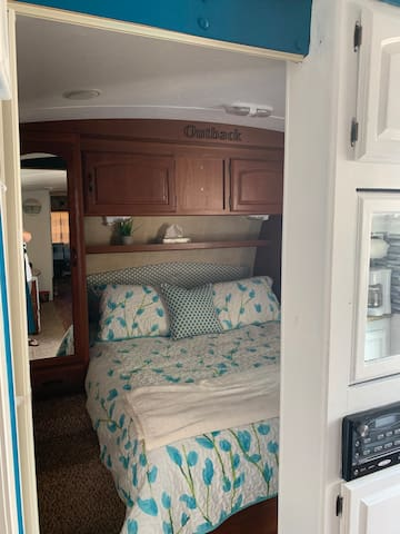 As you come in you will find you master with queen bed and 2 closets. There are doors you can close at nigh5 for your own personal privacy.
