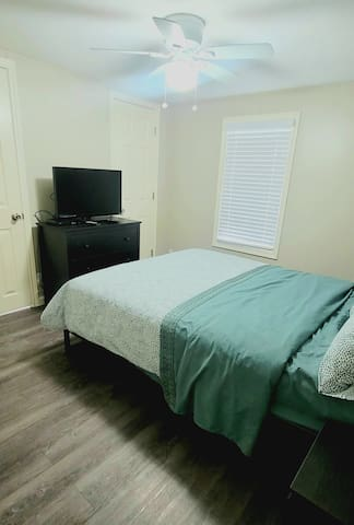 Bedroom 1 with queen size bed and 1/2 bath