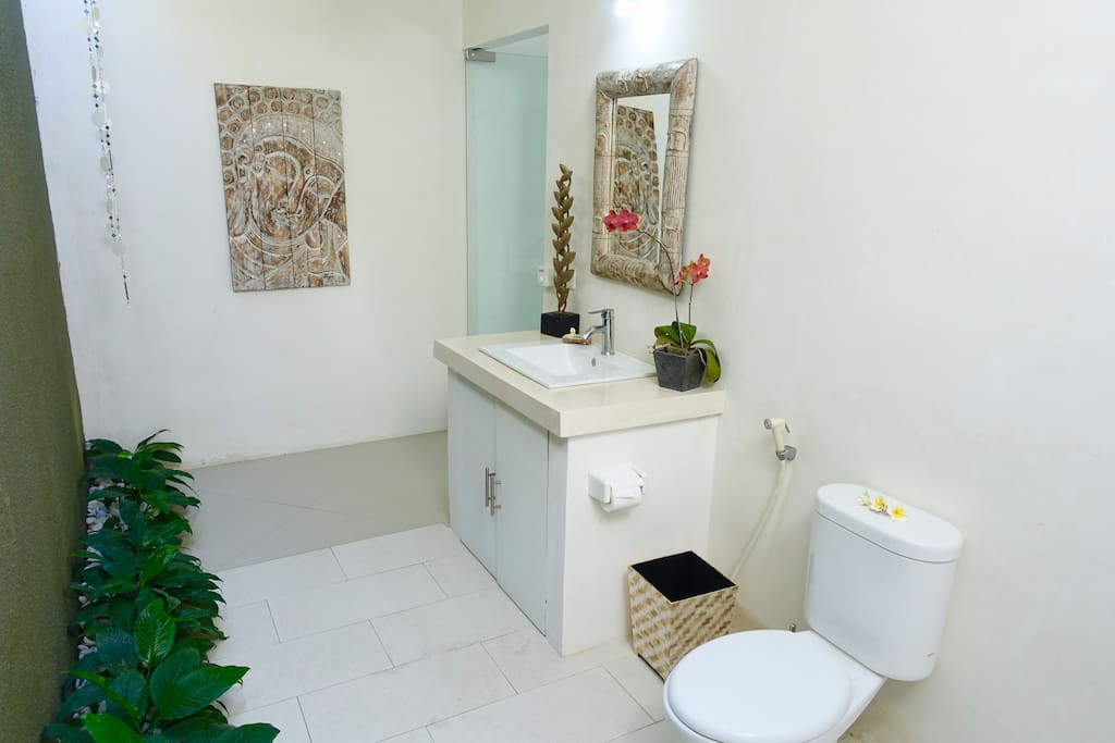 Ensuite Private Semi open bathrooms, with large ceiling fans and rain showers