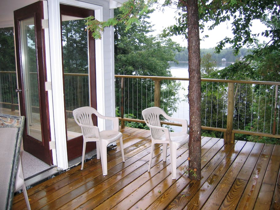 Huge deck wraps around in front of living room and master bedroom