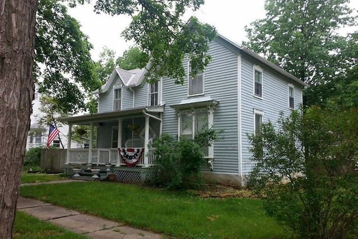 Over 100 y.o. home (with user friendly antiques)  located a on corner street. Off street covered parking provided