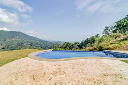 Secluded house on hilltop w/ infinity pool & stunning jungle views