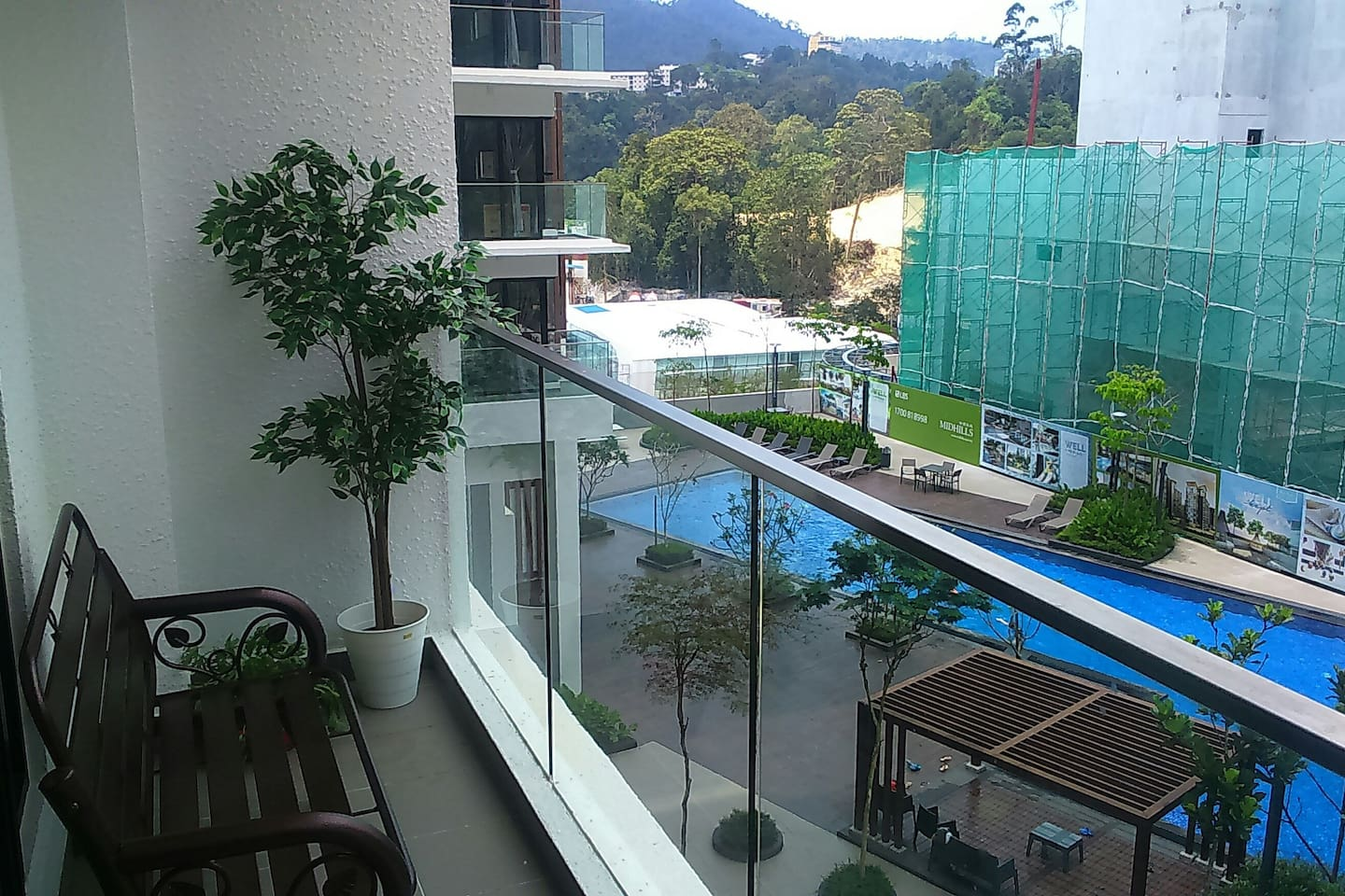 Balcony facing pool, gym & playground.  Opposite is developer-LBS Hotel.