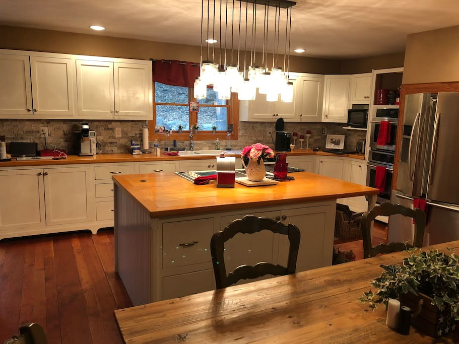 Large country kitchen with 8 per son  farm table