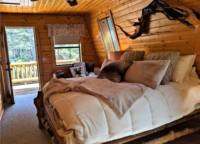 This is the master bedroom upstairs. There is a balcony for you to sit and enjoy morning coffee.