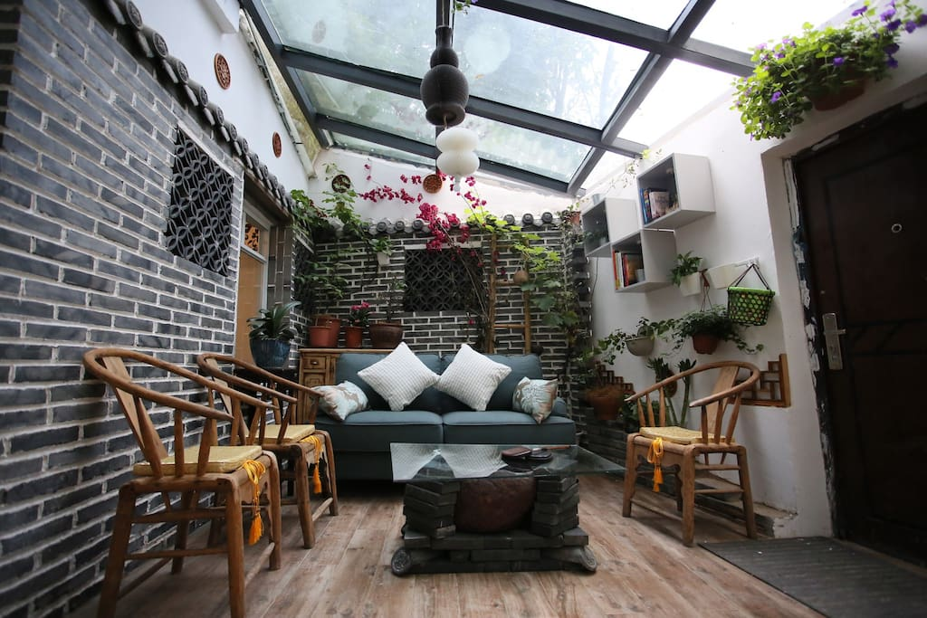 Sitting area with glass roof, natural lights with some Chinese decorations. There are very comfort Sofa with 55 inch TV, international channel provided, during the night may not stable between 6:00pm - 10:00pm because it is online TV channel. Free wifi with 200 M high speed.