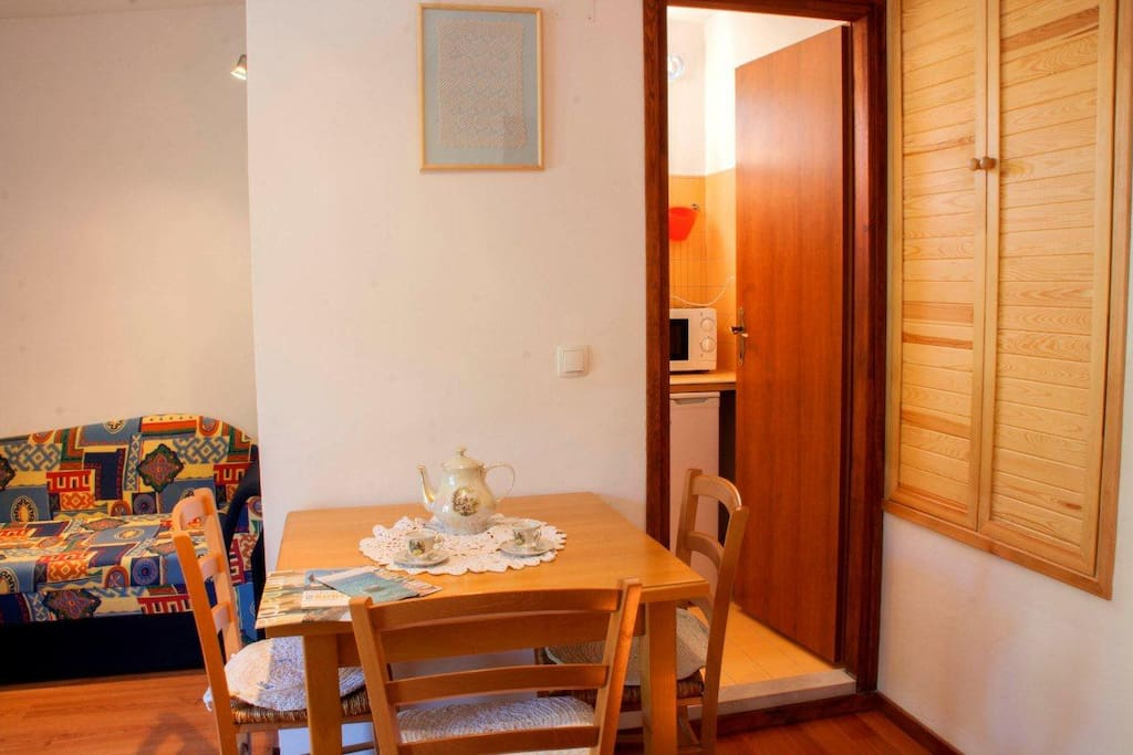 It has a dining area with a small but well equipped kitchen