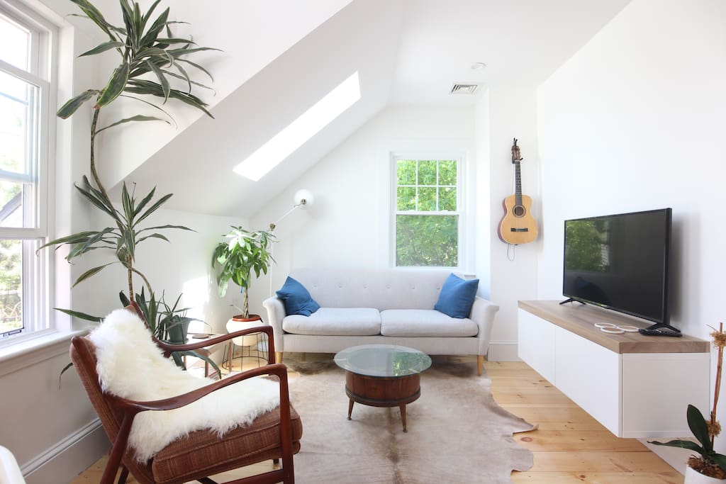 Bask in a sunny morning, binge some Netflix or read in the airy living room