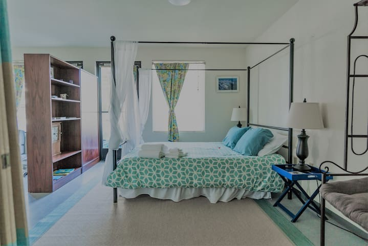 The wifi smart TV can be viewed from both sleeping/living areas. The queen sleeping area features a walk-in closet with beach chairs, small baggage roller, extra leaves for the dining area table, ironing board and iron, and plenty of storage shelves and hangers.