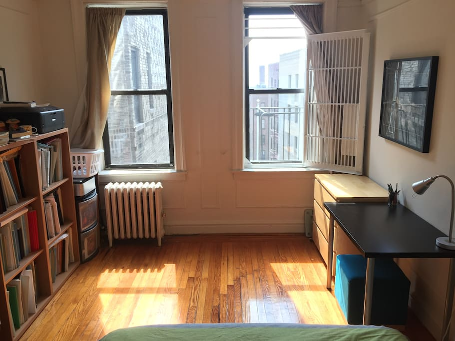 Bedroom is east-facing with wide open view all the way east over Manhattan. A spacious room with a closet, 3-drawer dresser, working desk, great light all day long.